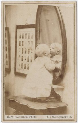 http://commons.wikimedia.org/wiki/File:Photograph_of_a_baby_standing_in_front_of_a_mirror.jpg