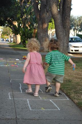 http://commons.wikimedia.org/wiki/File:Toddler_hopscotch.jpg